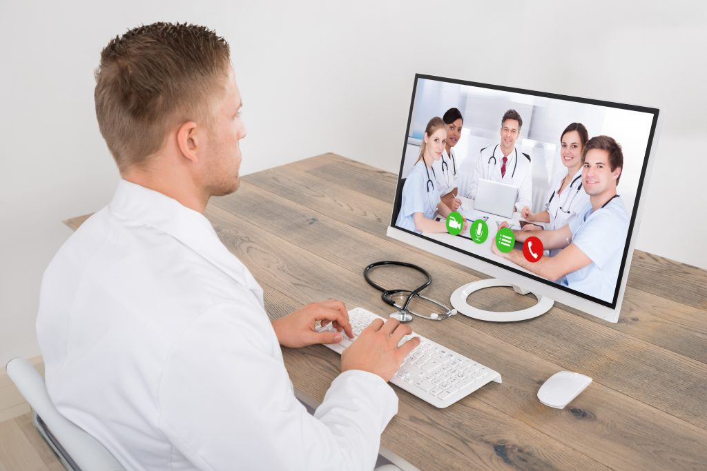 Doctor using Skype for telehealth